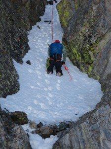 Opie Rappels down from Beehive Peak